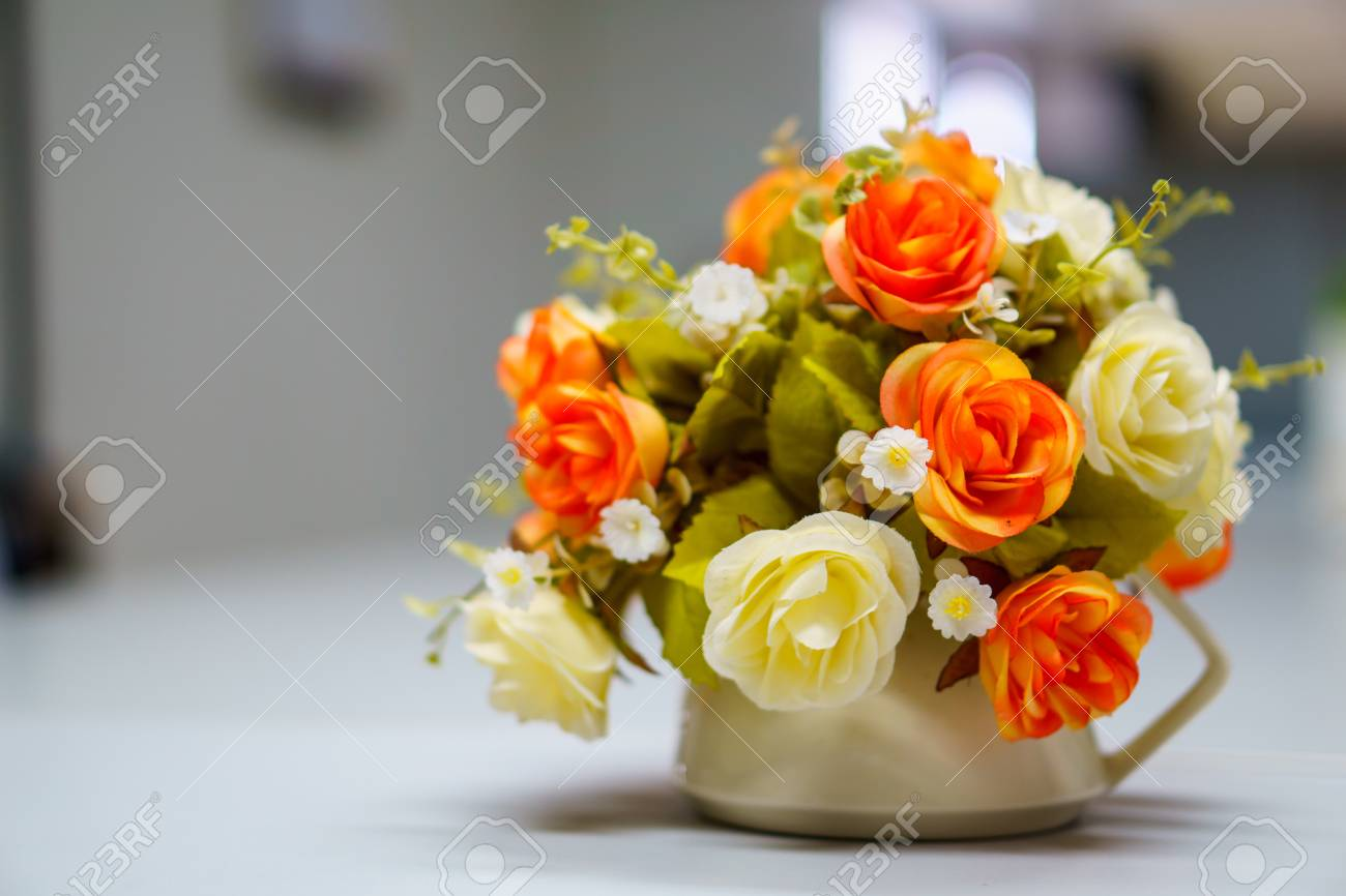 Fake Or Mock Up Bouquet Flowers In A Vase On The Table In Meeting