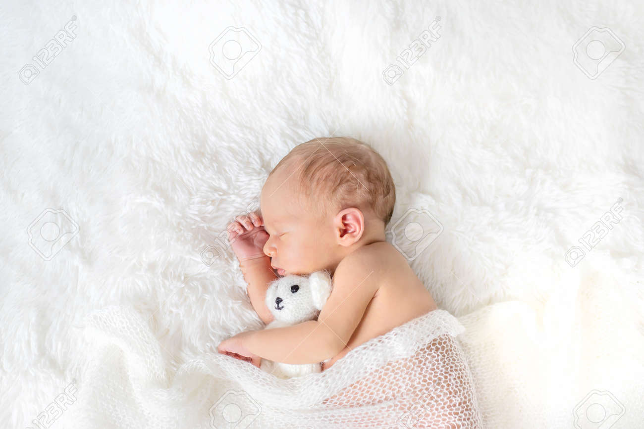 Newborn baby sleeping on a white background. Selective focus. people. - 157266795