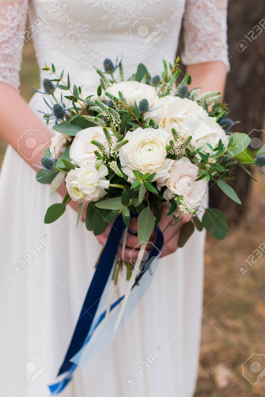 Bridal Bouquet With White Roses. Wedding. The Bride In White ...