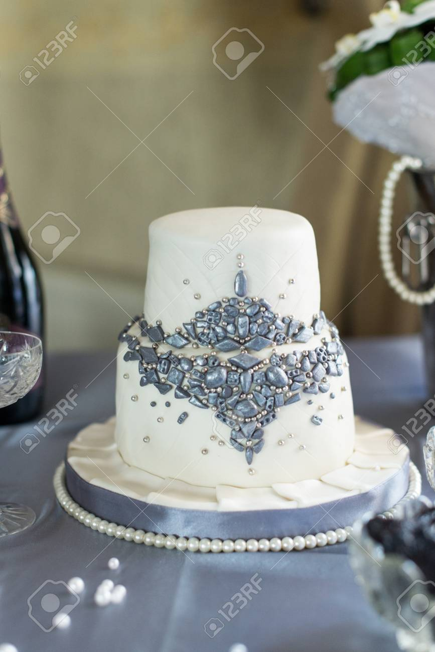 Beautiful White Two Tier Wedding Cake From The Mastic With Bead Stock Photo Picture And Royalty Free Image Image 72451092