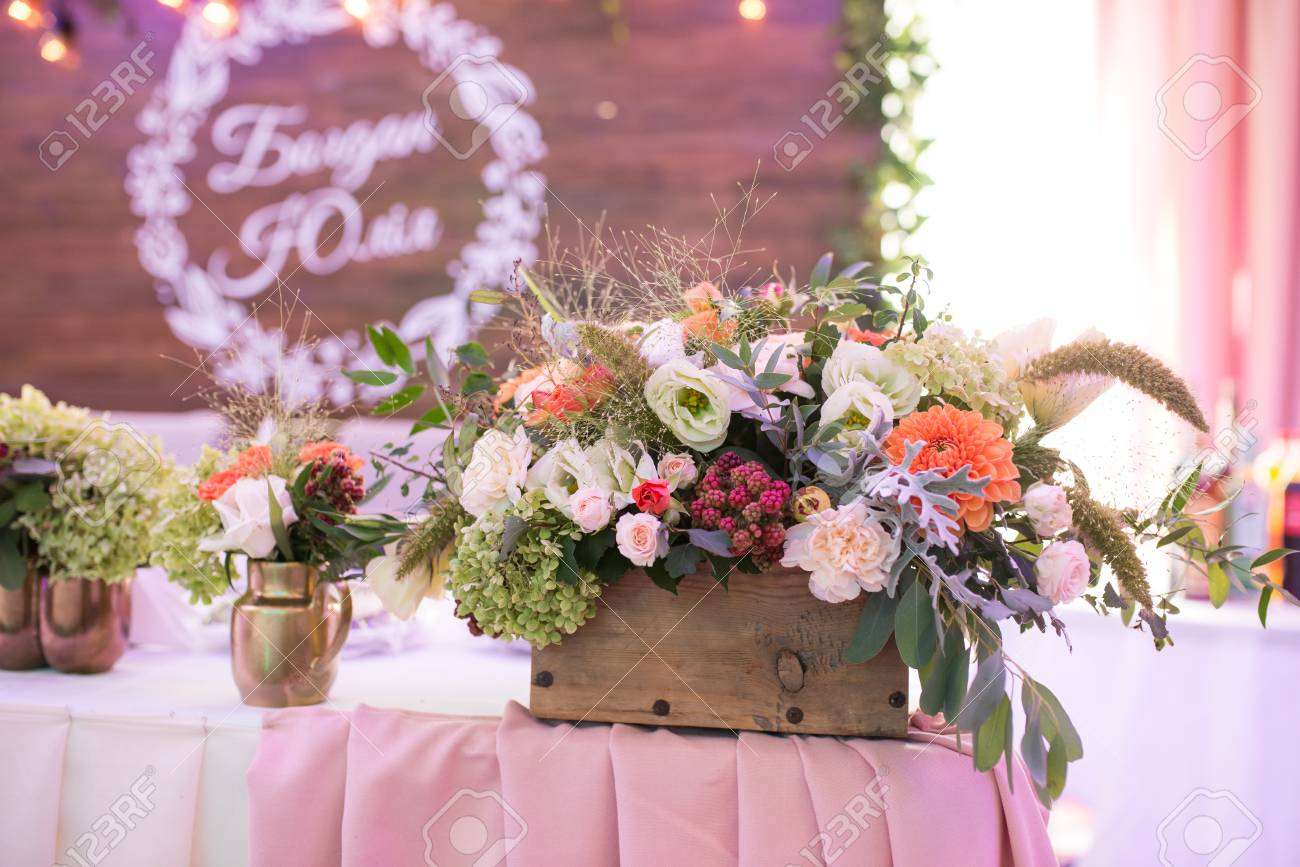 Rustic Flower Arrangement At A Wedding Banquet Table Set For