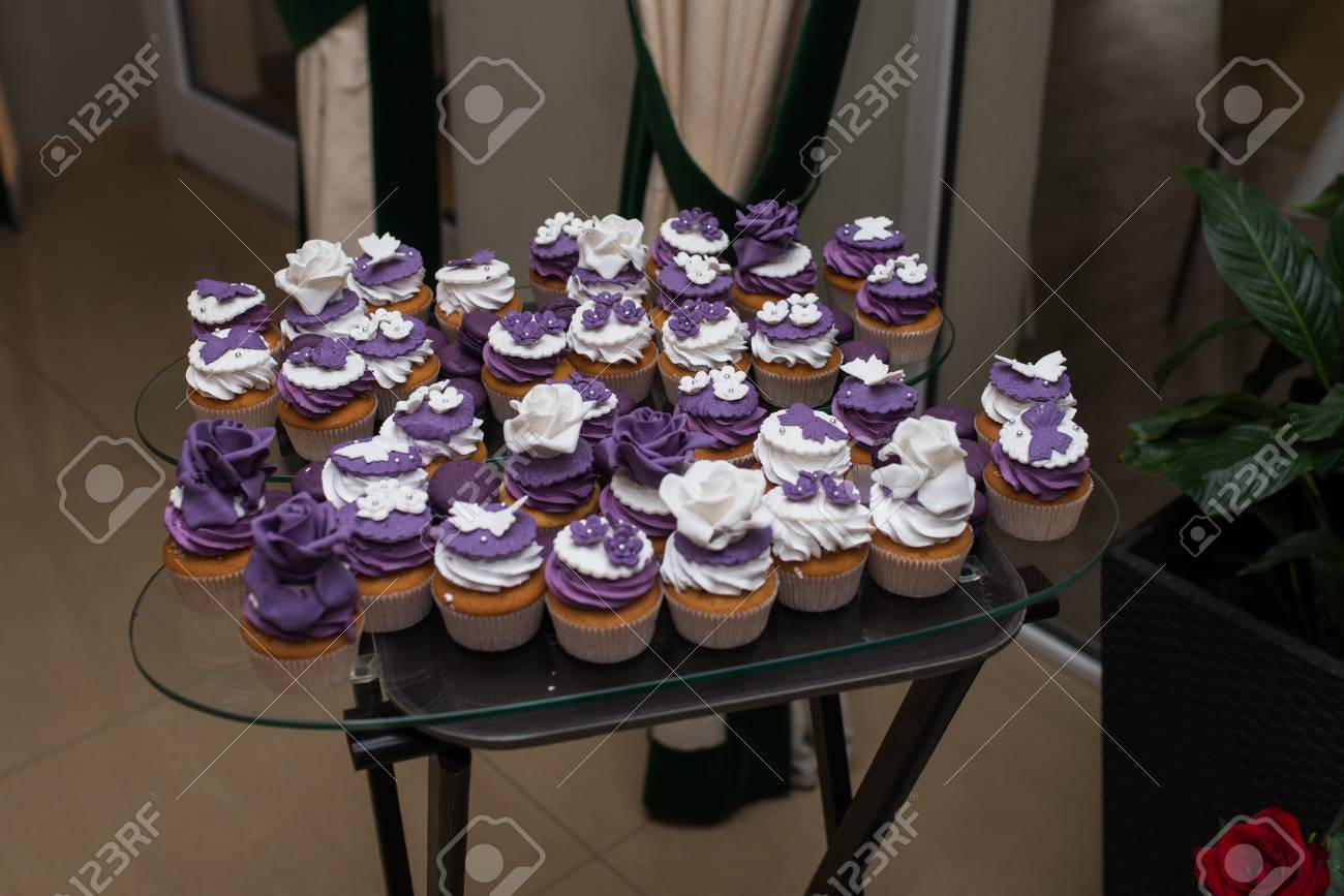 Muffins With Cream, Wedding Sweet Table. Purple And White Cupcakes ...