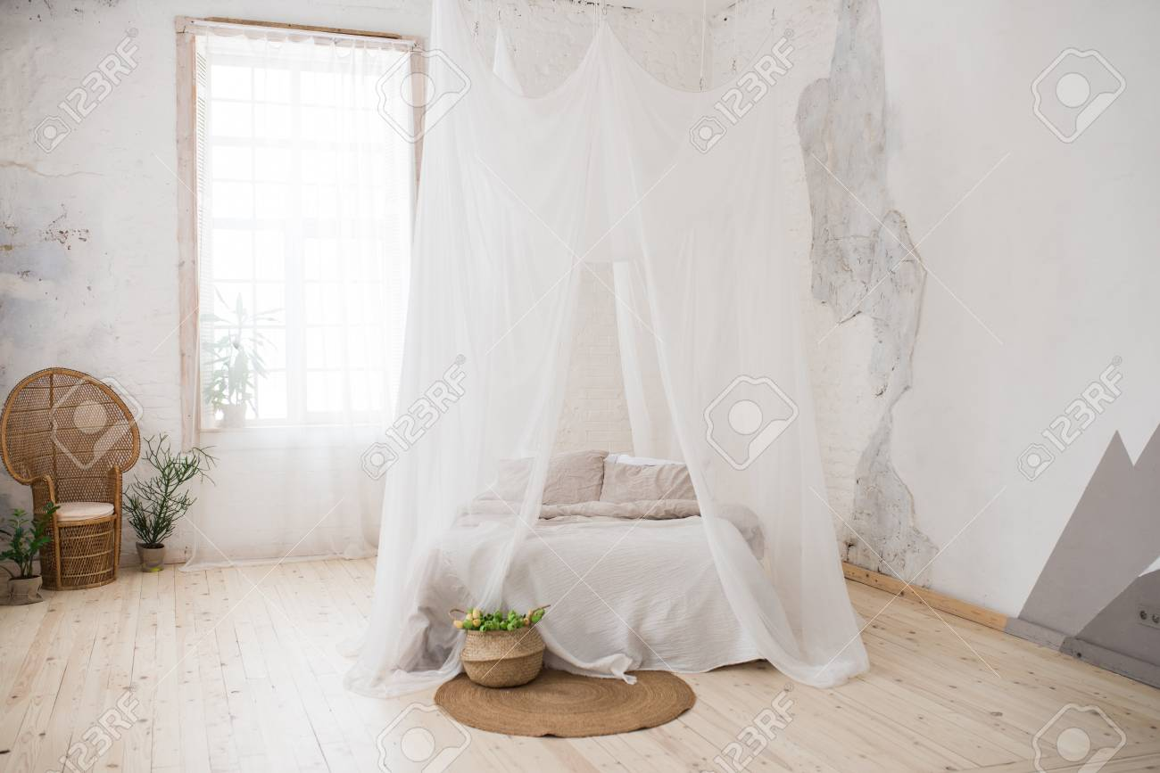 - Double Bed With Gray Bed Linen And Canopy. Bedroom. A Wicker
