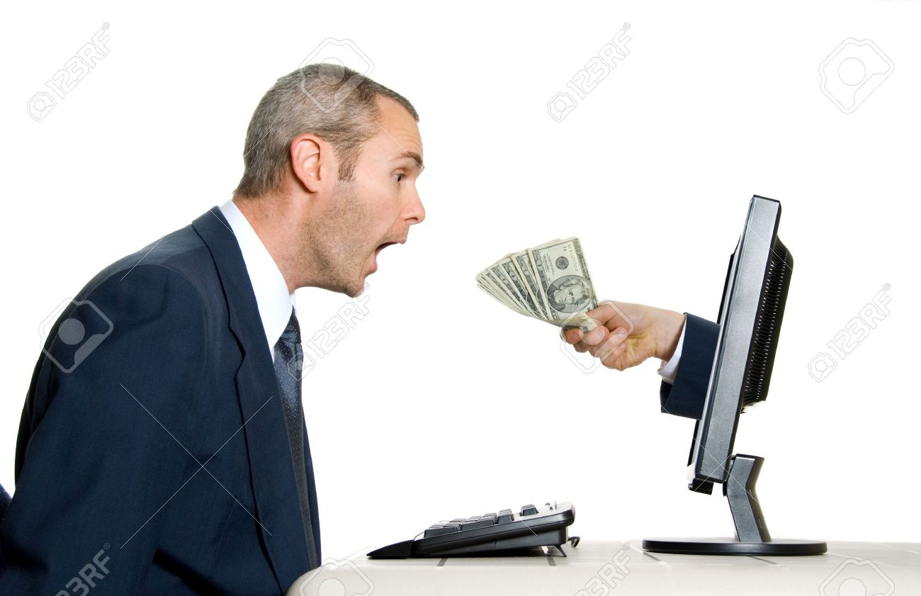 Surprised Man Getting Money From The Internet Stock Photo, Picture ...