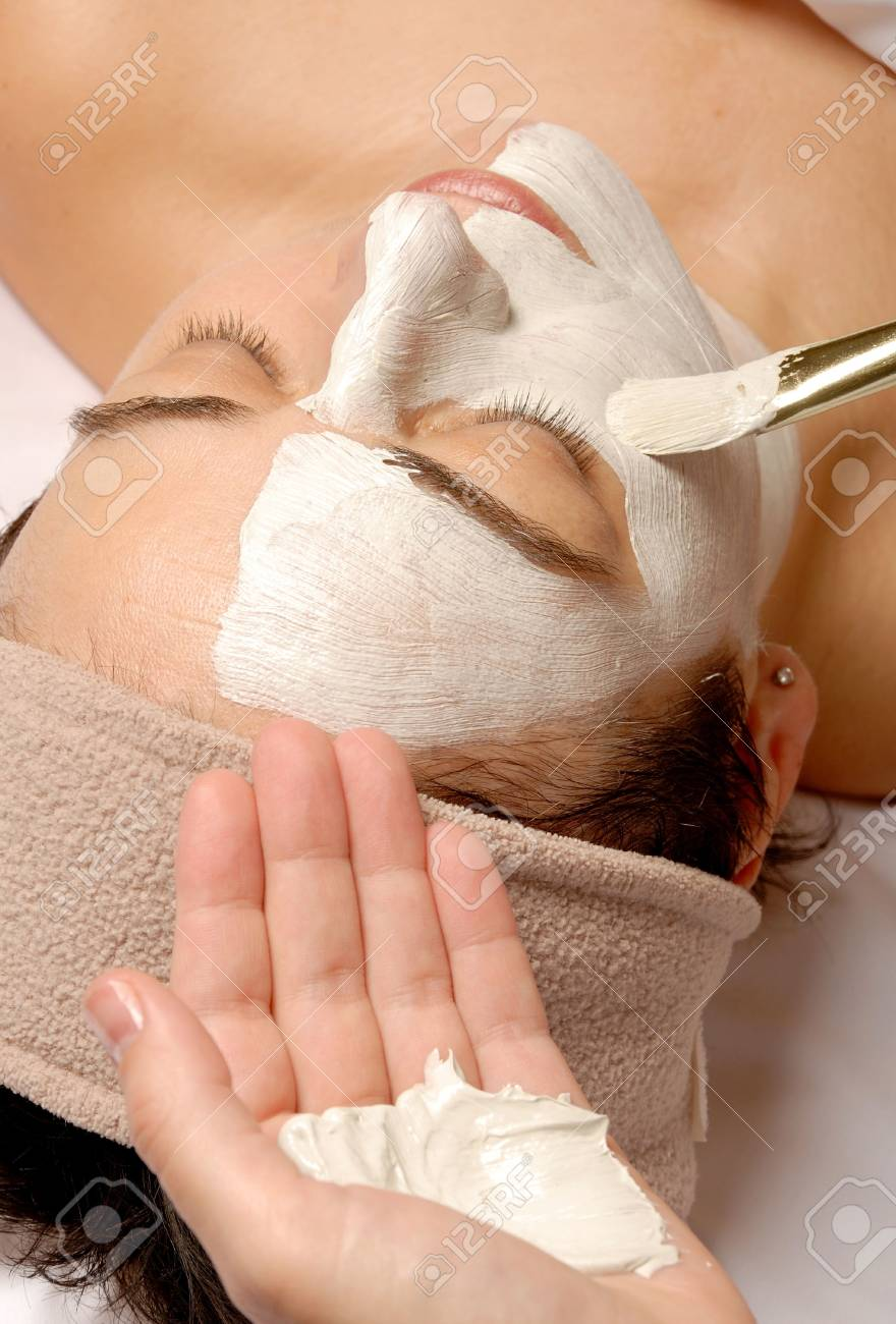 woman getting a facial with cream and a brush Stock Photo - 693789