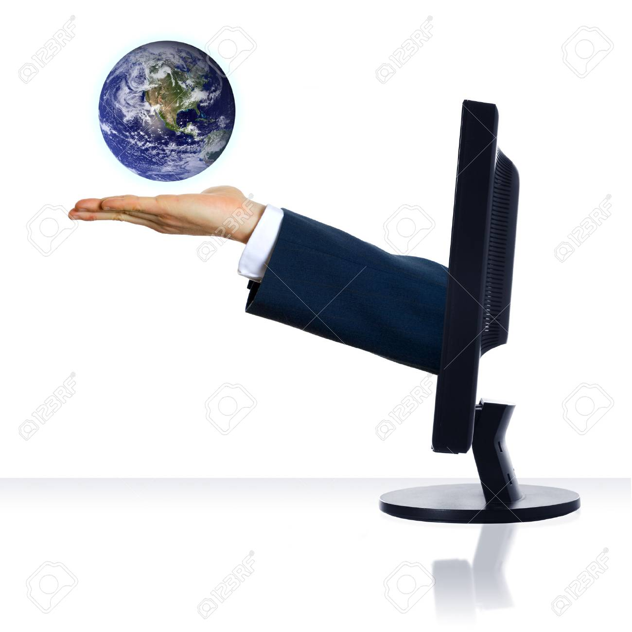 A hand from a monitor holding a planet Stock Photo - 1391491