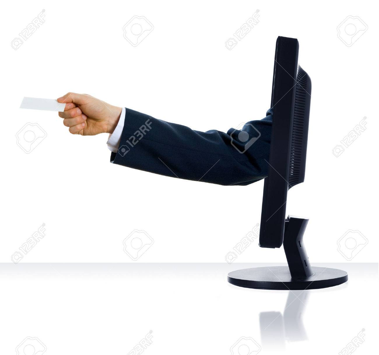 a hand sticking out of a monitor with a card Stock Photo - 1391489