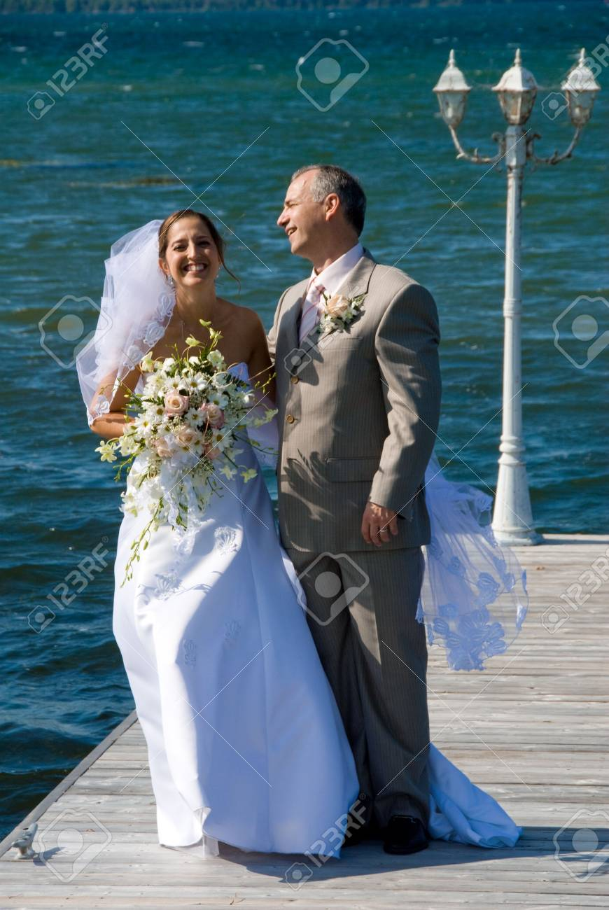 a just married man and woman by a lake Stock Photo - 1754225