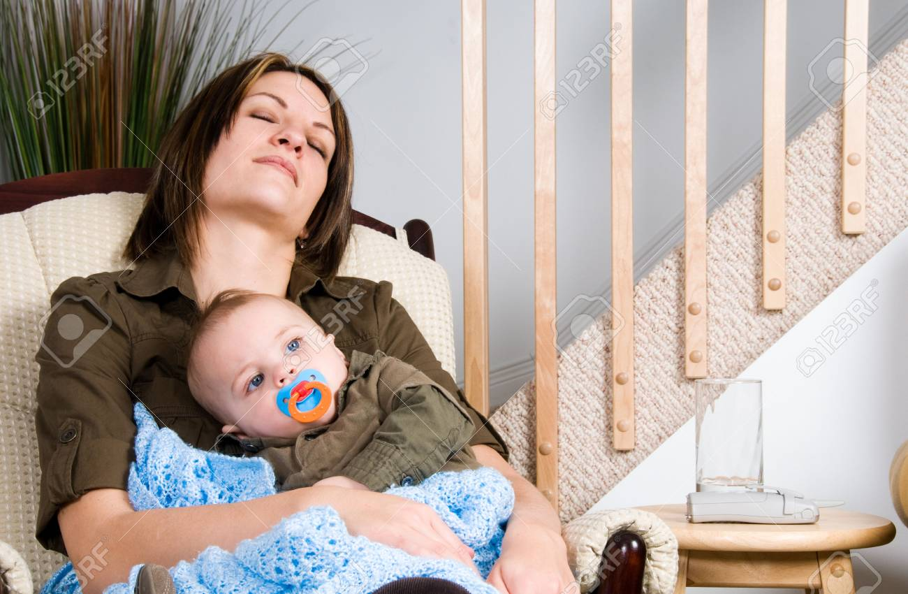 mother and her baby boy resting in a chair Stock Photo - 2661817