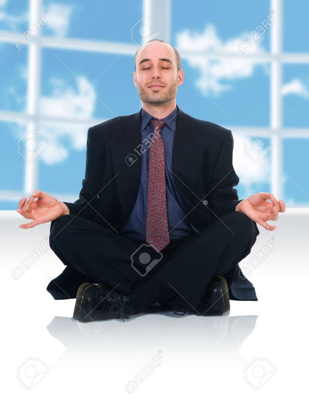 business man in a meditation position on white Stock Photo - 2977181