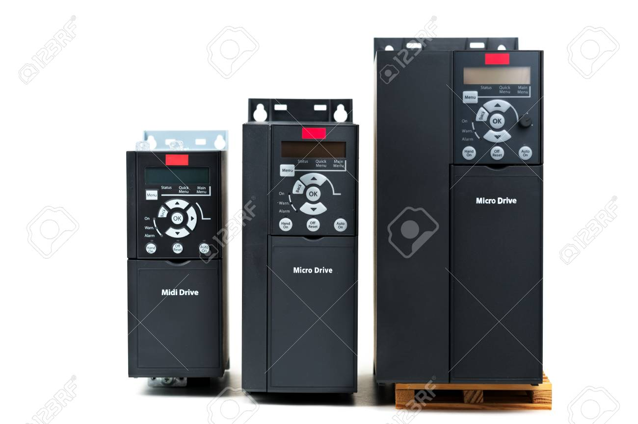 A group of three different sizes and capacities new universal inverter for controlling the electric current and power for industrial on a isolated white background. A frequency converter - rectifier - power stabilizer - 96087288