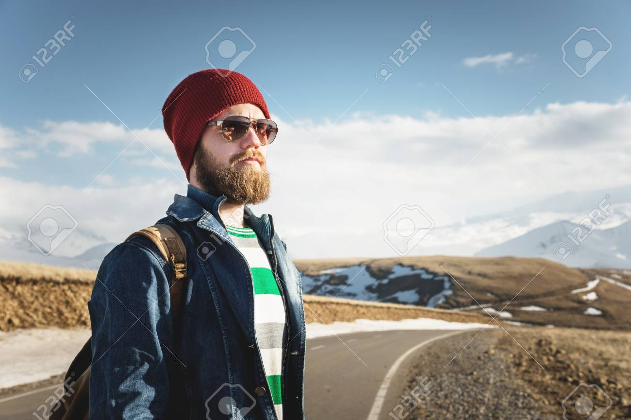 Portrait of a thoughtful stylish hipster with a beard in sunglasses and a  hat with a c6a7a5efc3ed