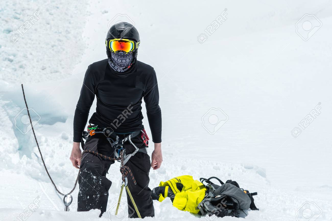 Mountain guide candidate training ice axe and rope skills on
