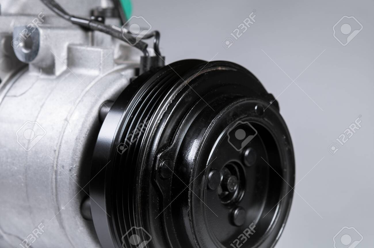 Close-up New car air conditioning compressor on grey background. - 135913338