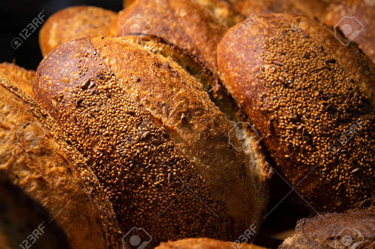 Freshly baked hot loaves of crispy artisan bread close-up. Healthy foods and proper nutrition - 172893543