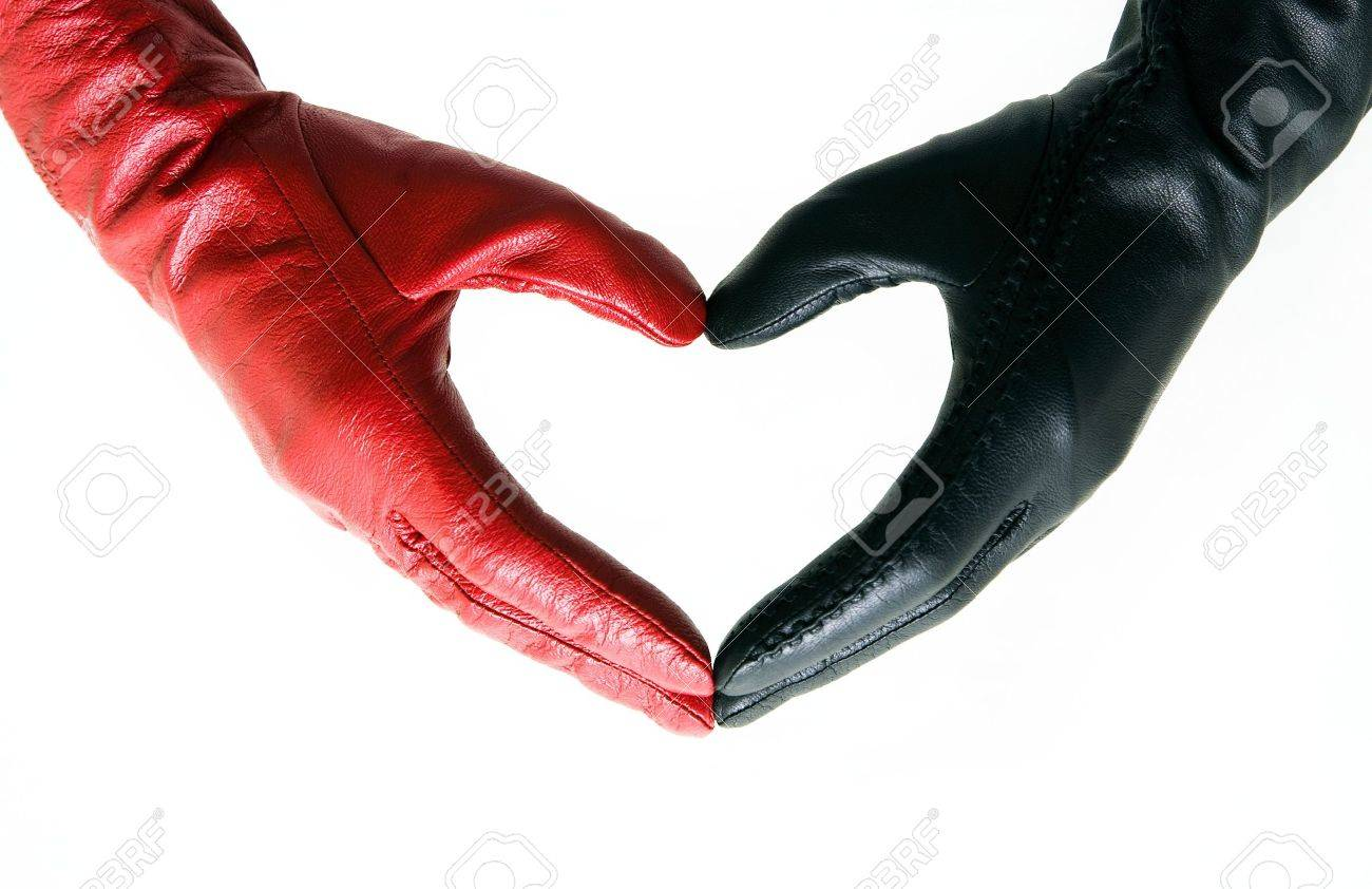Man's and female hands in gloves connected in heart Stock Photo - 6353632