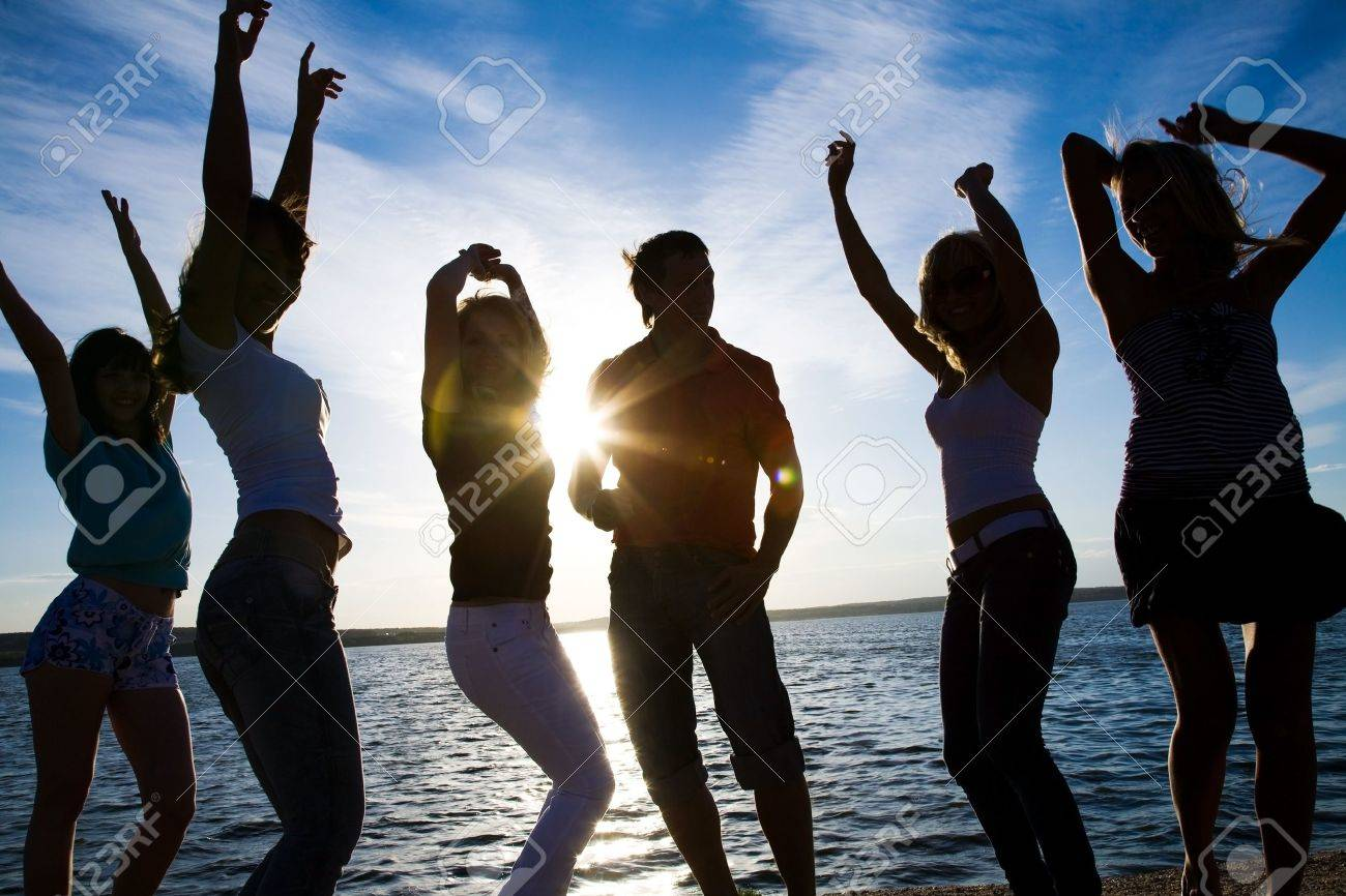 group of happy young people dancing at the beach on  beautiful summer sunset Stock Photo - 8685551