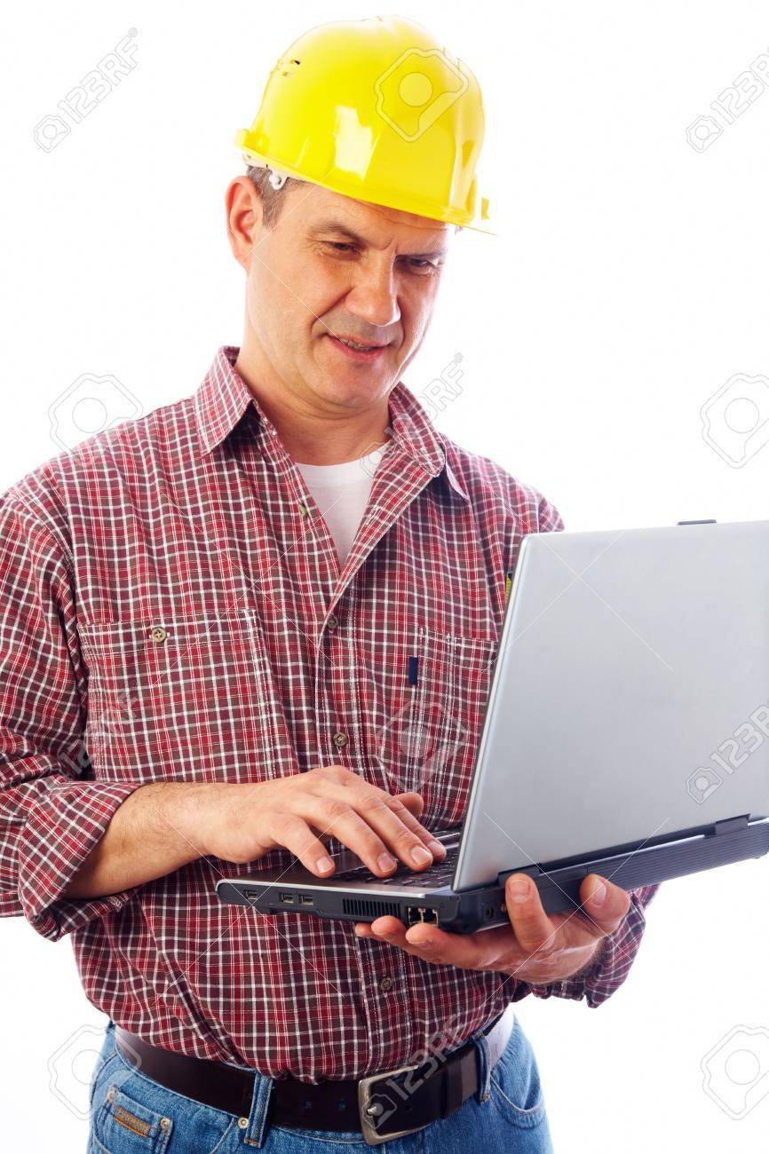 handsome man-builder in helmet examining on a laptop on a white background Stock Photo - 9132484