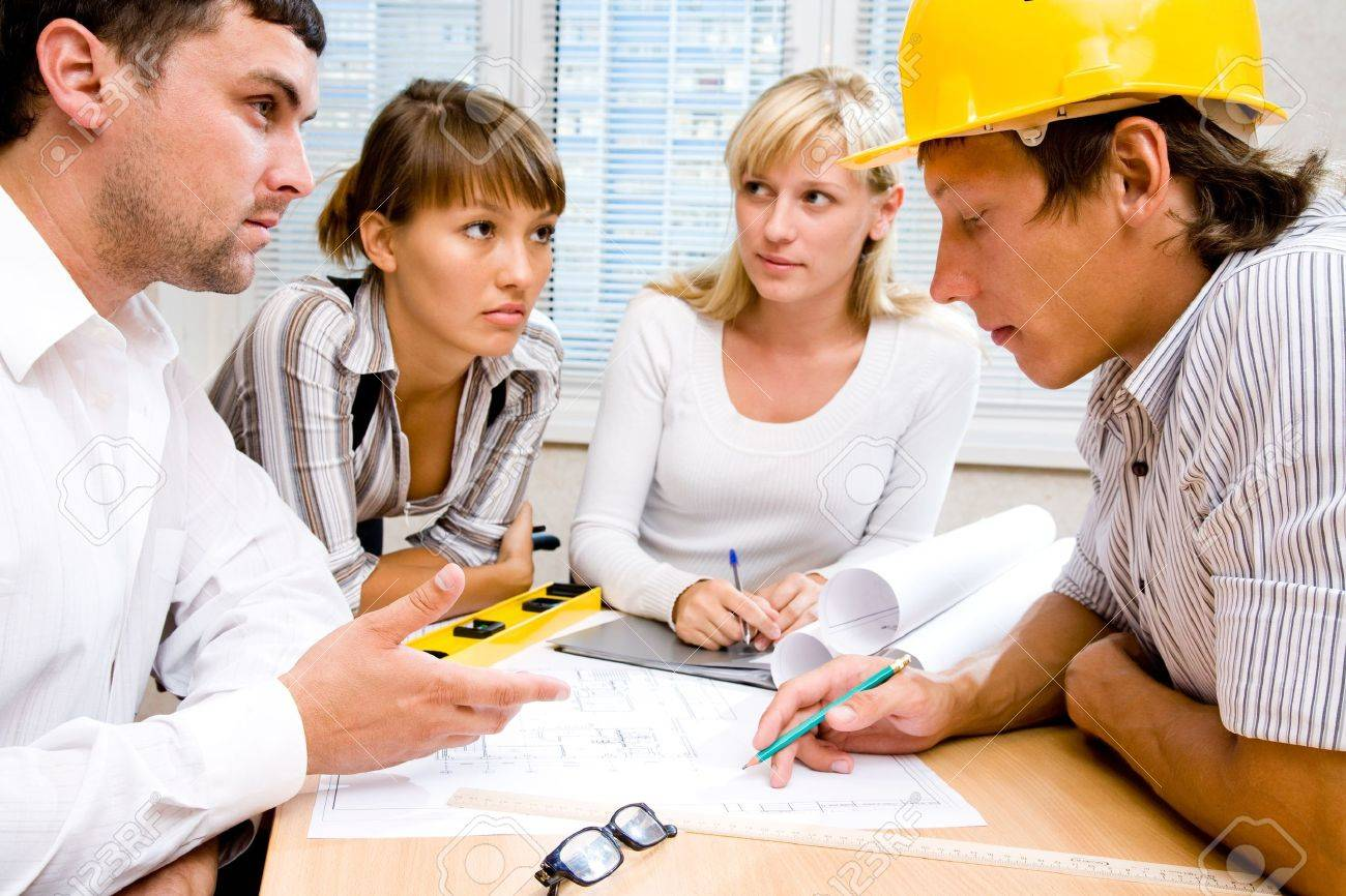 Meeting the team of engineers working on a construction project at the table Stock Photo - 10932793