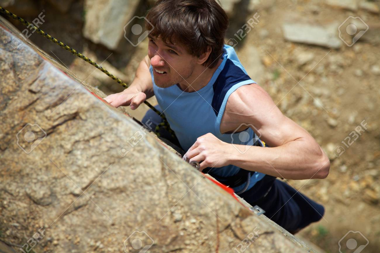 Photo of young man climbing up the rock Stock Photo - 9131974