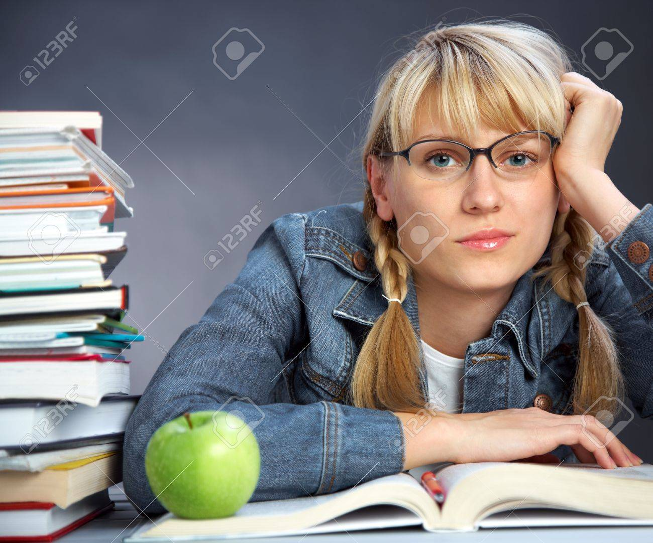 portrait of tiredness girl student reading  book in classroom Stock Photo - 10229305