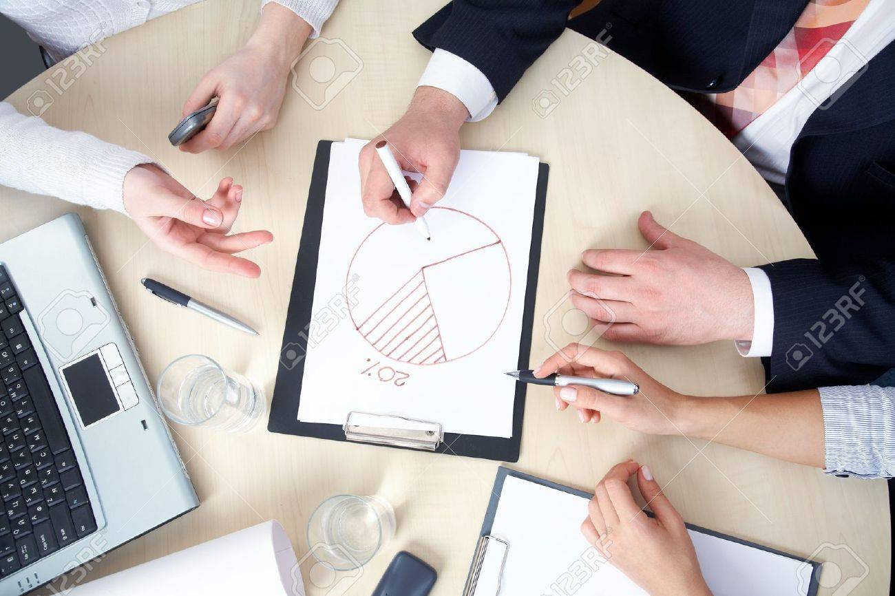 young businesswoman drawing graph on chart in office Stock Photo - 10250517