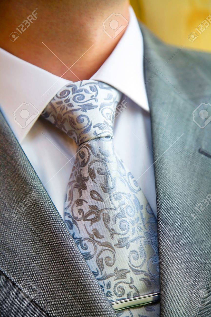 A stylish man in an expensive suit and tie and jacket, close-up. Unrecognizable. Stock Photo - 10499463