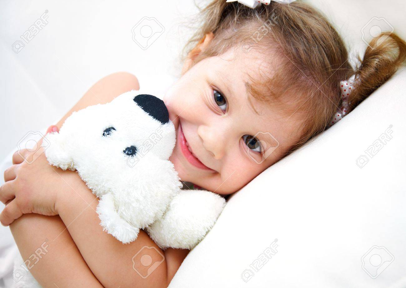 Portrait of little girl with teddy bear on white background Stock Photo - 10511718