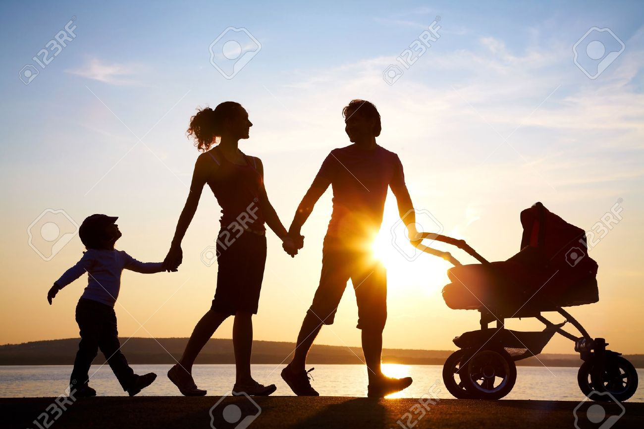 Silhouettes of happy parents walking with child and babys stock silhouettes of happy parents walking with child and babys stroller on the seacoast stock photo thecheapjerseys Image collections