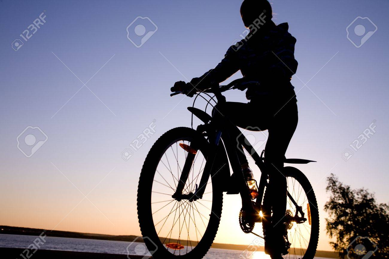 silhouette of cyclist in motion on the background of beautiful sunset Stock Photo - 10571990