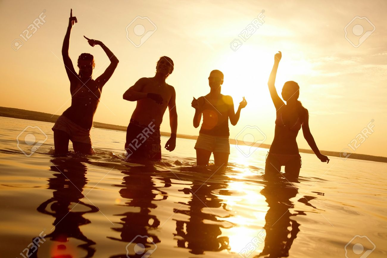 group of happy young people dancing at the beach on  beautiful summer sunset Stock Photo - 10588619