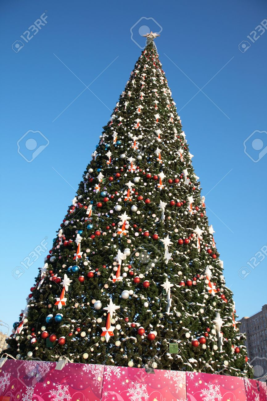 Large Outdoor Christmas Tree In Snow And Ornaments