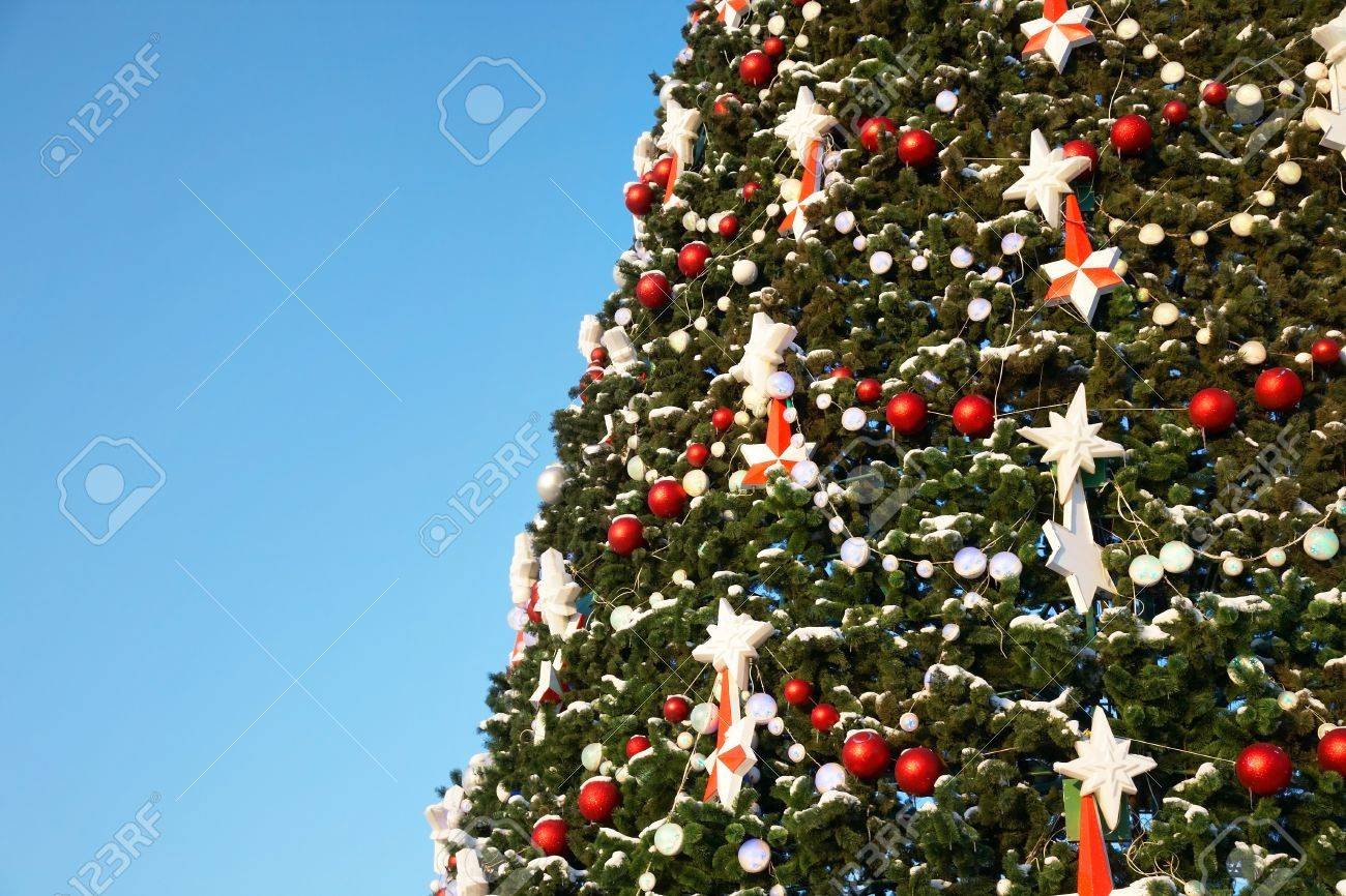 Part Of Large Outdoor Christmas Tree In Snow And Ornaments Stock Photo   10617084