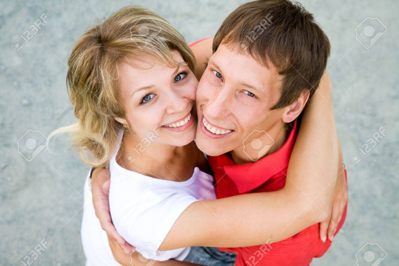 Portrait of a beautiful young couples are happily embracing at walk. Top view Stock Photo - 10603151