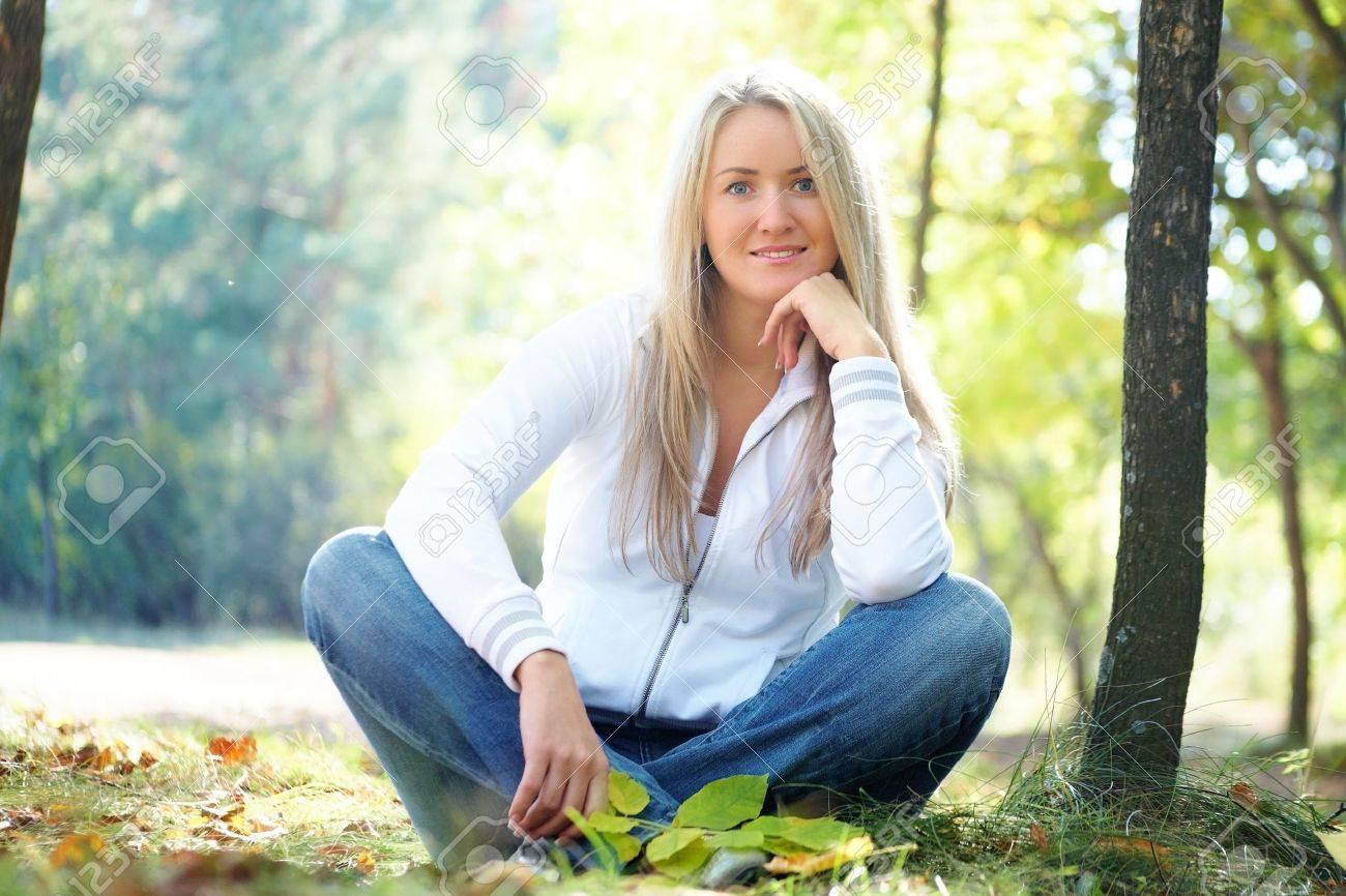 Portrait of a beautiful blonde woman in autumn park Stock Photo - 10718741