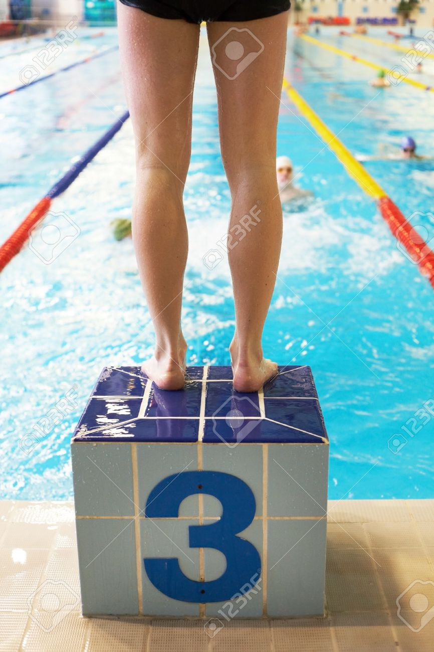 Legs of male swimmer before jumping in swimming pool Stock Photo - 12169538