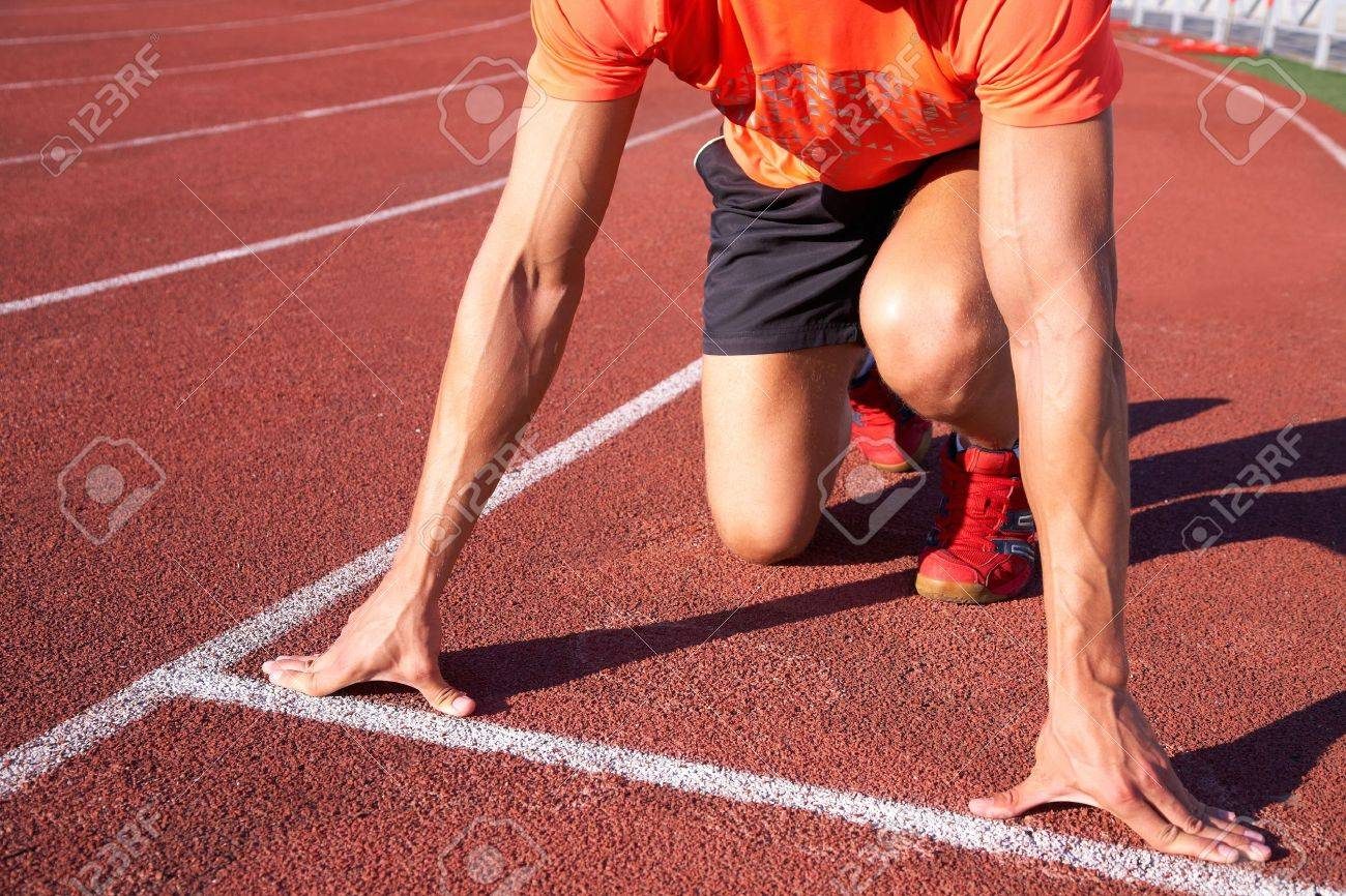 young muscular athlete is at the start of the treadmill at the stadium Stock Photo - 12508129