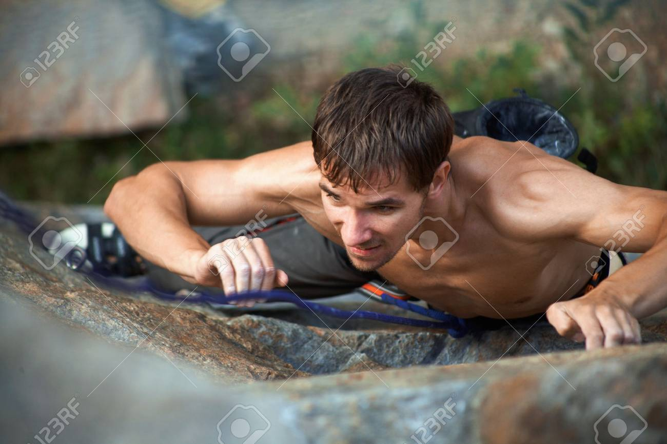 Photo of young man climbing up the rock Stock Photo - 12508140