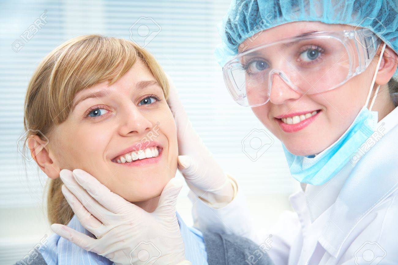 Portrait of smiling female patient  with dentist Stock Photo - 12838776