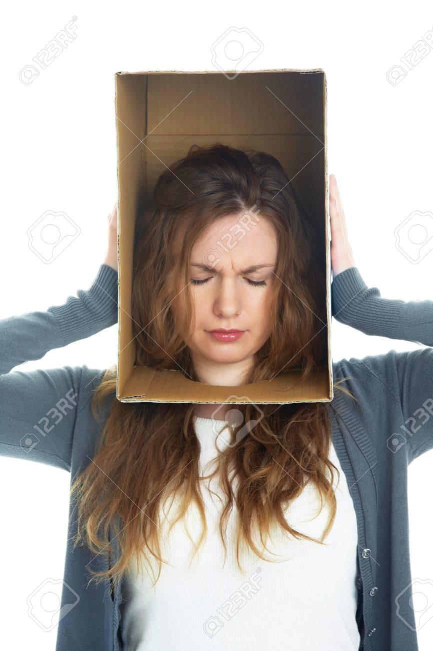 conceptual portrait of a woman's head hidden in a cardboard box Stock Photo - 12969054