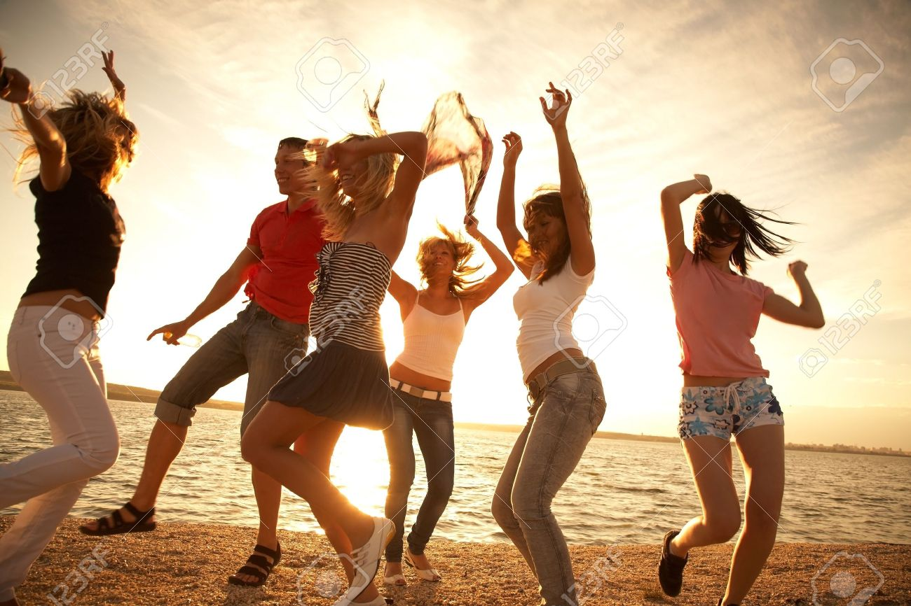 Group Of Happy Young People Dancing At The Beach On Beautiful Stock Photo Picture And Royalty Free Image Image 12968951