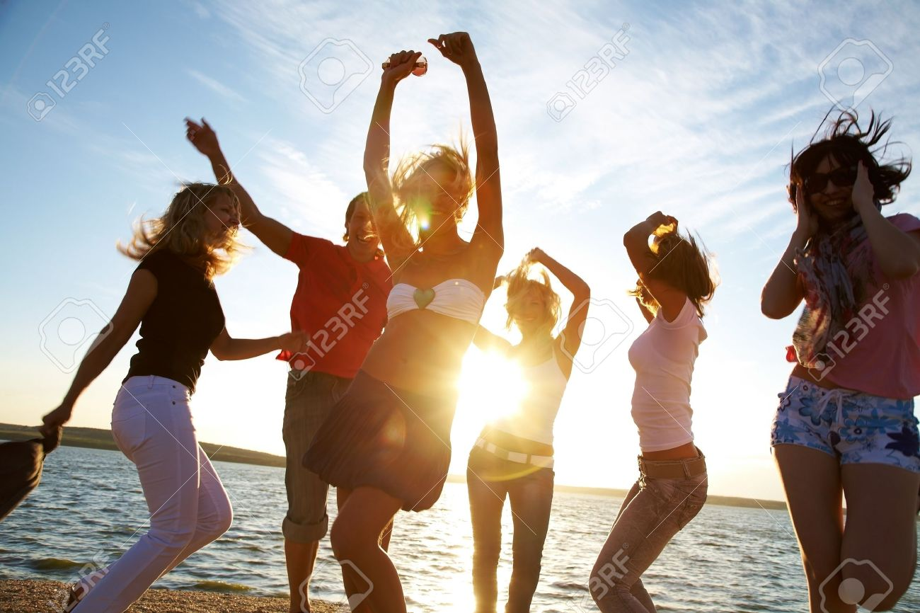 group of happy young people dancing at the beach on  beautiful summer sunset Stock Photo - 12968089