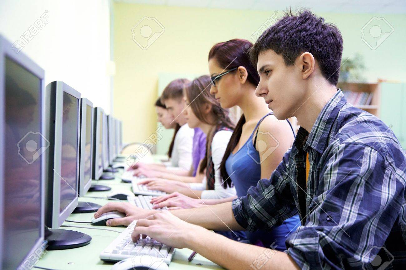 group of teens in internet-cafe with computers Stock Photo - 13258179