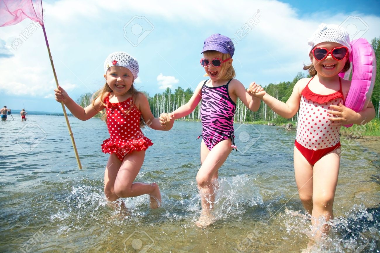 Three little funny  cute girls running on coast together Stock Photo - 13722509