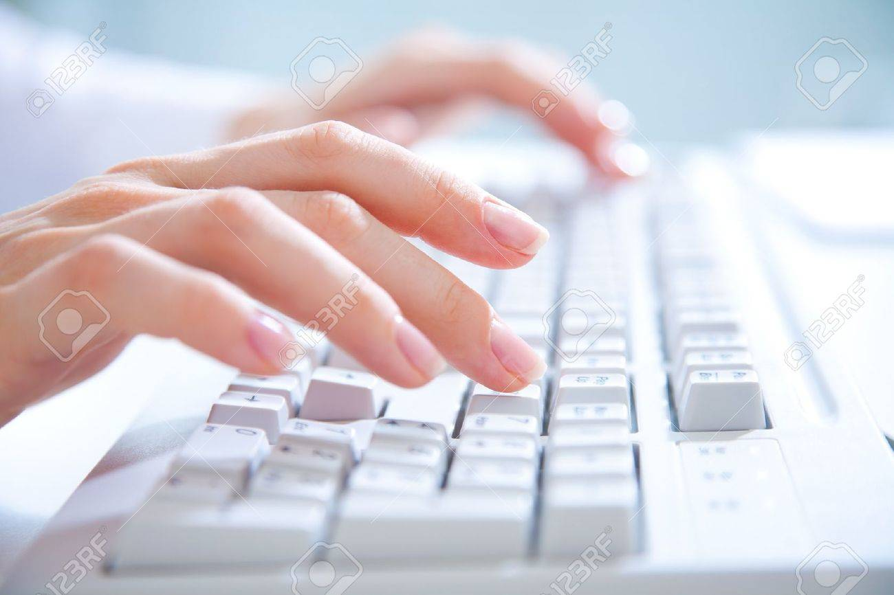 Female hands typing on white computer keyboard Stock Photo - 14386525