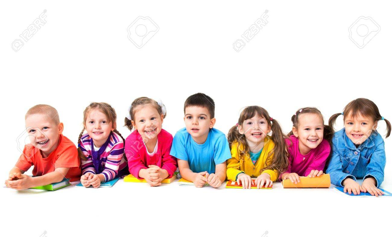 school children group of seven children are lying on floor with copybooks together - Free Images Children