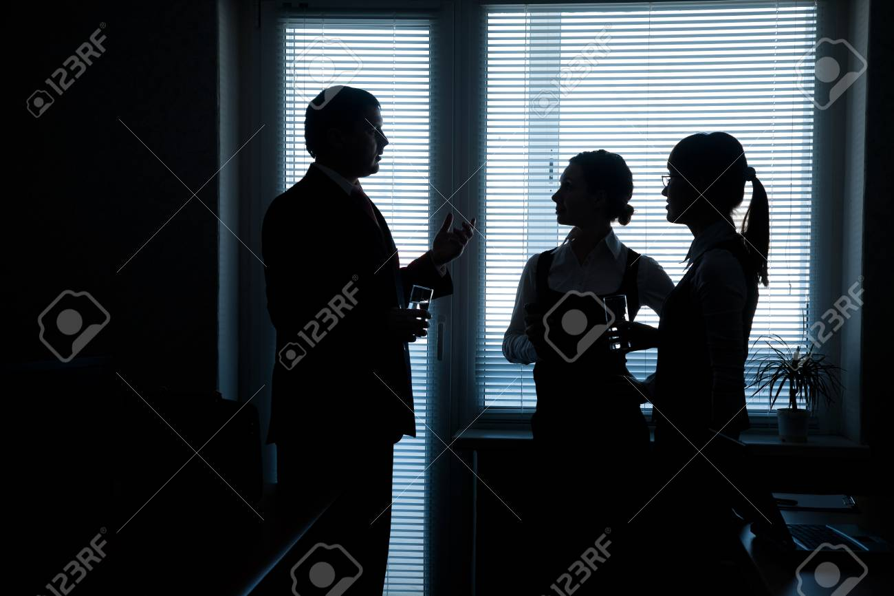 silhouettes of business partners discuss against the window in the office Stock Photo - 16374657