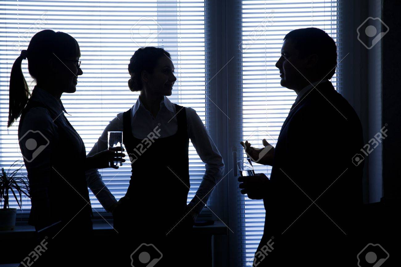 silhouettes of business partners discuss against the window in the office Stock Photo - 16374658