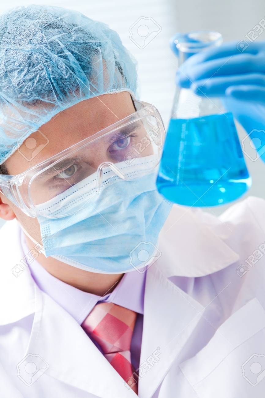 man scientist holding a test tube with liquid Stock Photo - 17467356