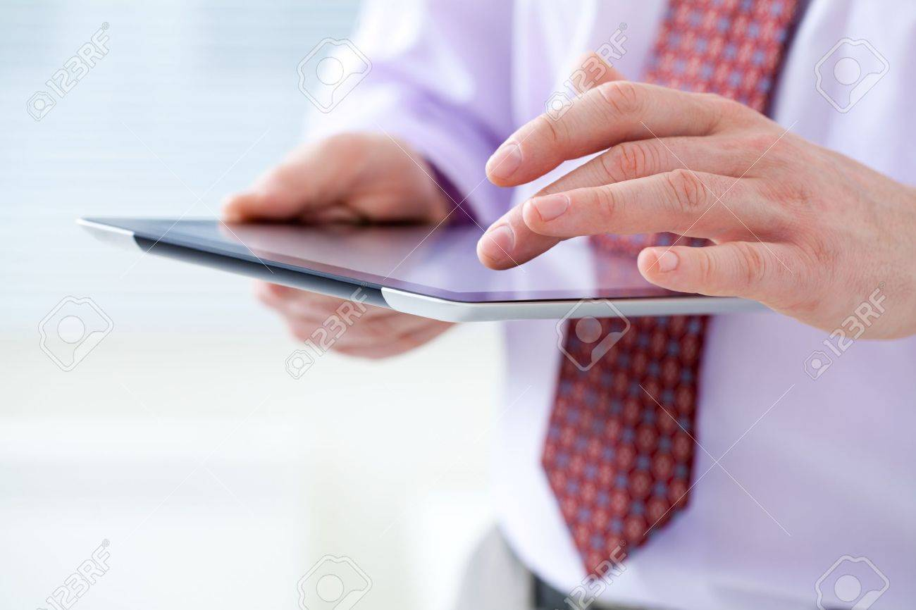 Unrecognizable business man holding a digital tablet Stock Photo - 18386862